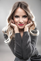 Attractive blond hair woman portrait.