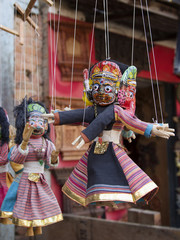 Souvenir puppets hanging in  the street shop in Bhaktapur, Nepal