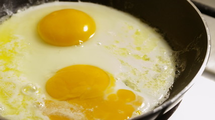 Fried eggs preparation on a pan, time lapse