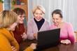 Senior women working with notebook