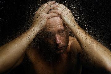 Man Behind Wet Glass