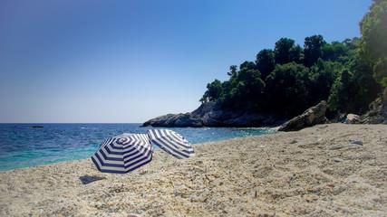 Two umbrellas on the beach