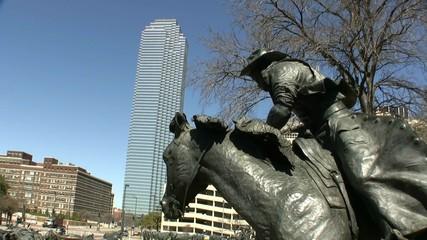 Bronze Cowboy And Skyline Dallas Texas