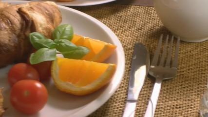 Breakfast with croissant end orange juice