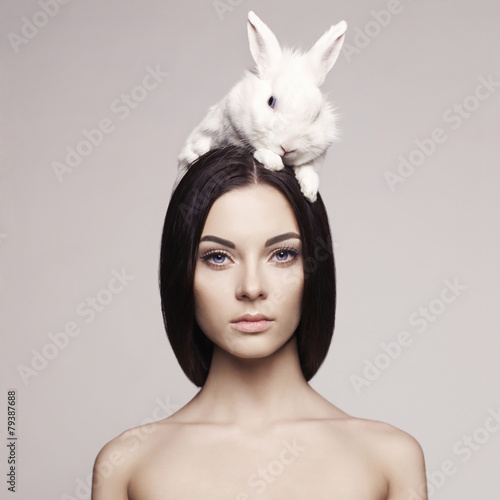 Beautiful woman with rabbit - 79387688