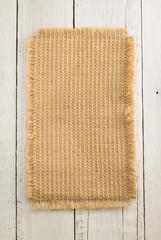 burlap hessian sack on wood