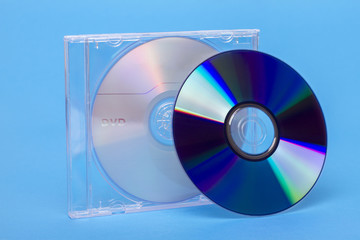 Close view of a jewel case with virgin dvd and cd discs.