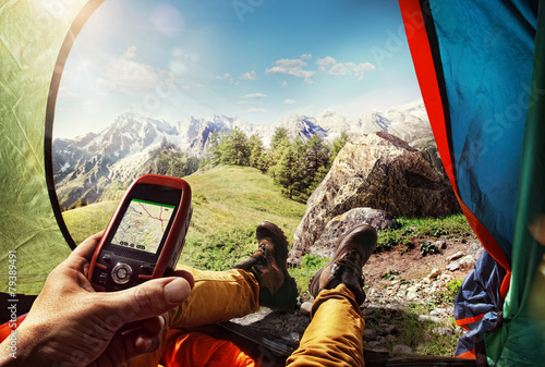 Tuinposter Alpinisme Sport.Tourism. GPS navigator in hand