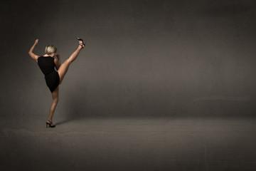 woman kicking empty space