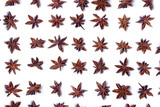 Top view row of aromatic star anise pods. poster