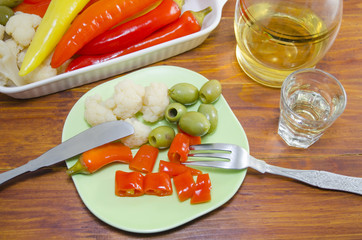 Pickled pepers, cauliflower and olives on a plate