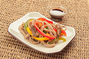 noodle with meat and vegetables on a plate
