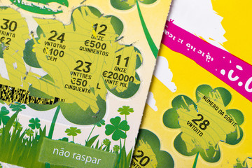 Two scratching lottery tickets in Portugal used in 2014.