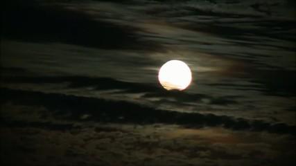moon behind clouds