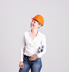 Archictress in Safety Helmet is Holding a Building Plans
