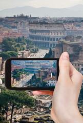 tourist taking photo of street to Coliseum, Rome