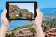 tourist taking photo city Taormina