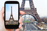 tourist taking photo of Eiffel tower in Paris - Fine Art prints