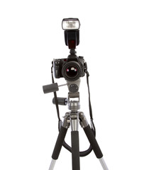 Tripod and dslr camera isolated on white
