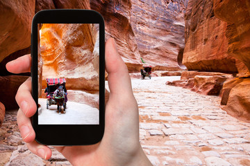 taking photo of carriage in Siq passage to Petra