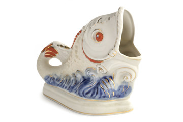 Old porcelain figurine of a fish.