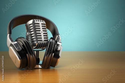 canvas print picture Vintage microphone and headphones on green background. Concept a