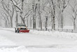Truck with snowplow clearing road during snowstorm - 79397489