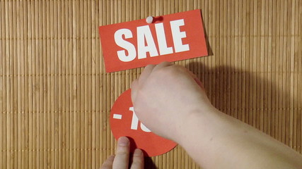 The video shows price labels. Sale