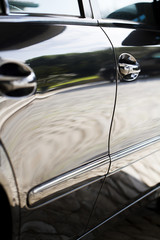 Close up detail of the door sides of a automobile.