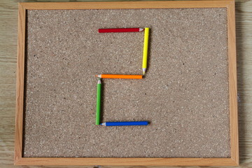 Board and numbered and colored pencils