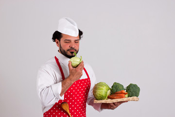 Chiefcook is Holding Tray of Vegetables and Smells a Cole