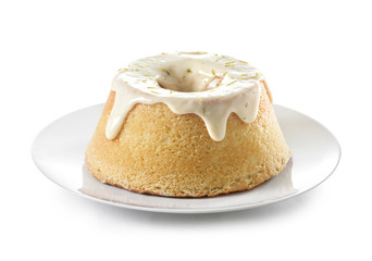 A lemon sponge cake with icing and lime rind