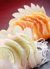 Raw cod and salmon sushi dish.