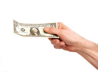 Mano sujetando un billete de dólar,concepto de consumo.