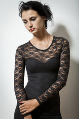 Gorgeous Woman in Black Dress Carrying her Jacket