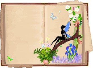 Old open book with fairy