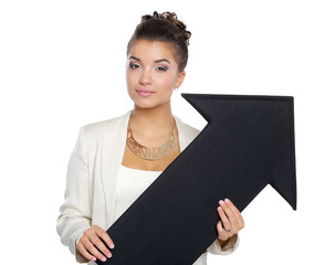 Beautiful young business woman holding black arrows, over a