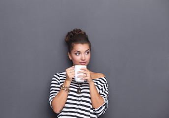 Portrait  a young woman with cup of tea or coffee