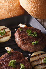 Burger with onion in a pan grill. close up vertical