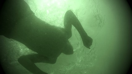 Swimming and playing underwater at beach Lake Michigan