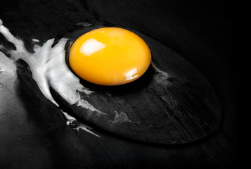 Raw Egg on Smooth Black Surface