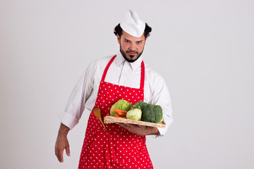 Italian Headcook Holds a Tray with Vegetables