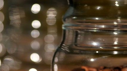 Roasted coffee beans in bottle, close up