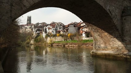 Ancient stone bridge Pont du Milieu in Fribourg, Switzerland