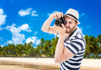 Tourist taking photos in the beach