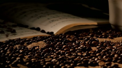 Coffee beans and music on sacking, black background