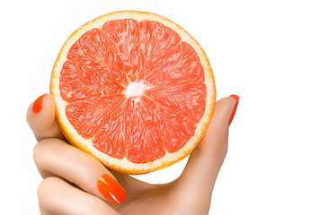 Female Hand Holding a Luscious Healthy Grapefruit. Isolated