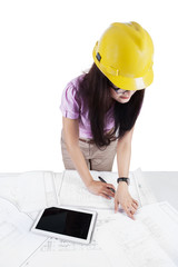 Engineer working with blueprints on desk