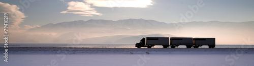 Semi Truck Travels Highway Over Salt Flats Frieght Transport - 79410219
