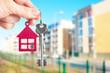 Handing keys in the house background - 79410849